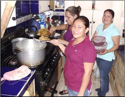 Diana                                                       Francis and Carmen                                                       cooking for                                                       delegations