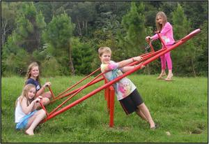 Eibhlin - Orla -                                                   Zaydra - and Nevlyn on                                                   see-saw