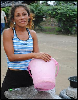 pila woman with                                                   bucket