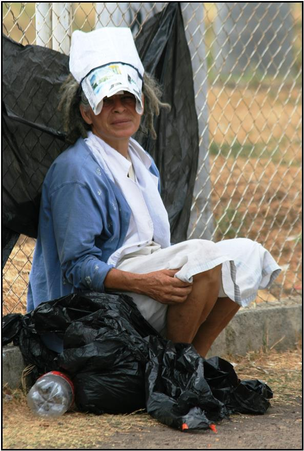 woman with                                                     plastic bags for                                                     shoes